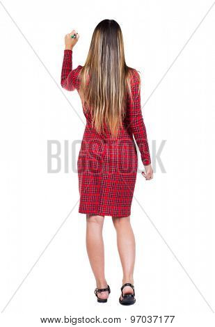 back view writing beautiful woman. Young girl in dress. Rear view people collection.  backside view person. Isolated over white background.  Long-haired girl in a red plaid dress draws a felt-tip pen.