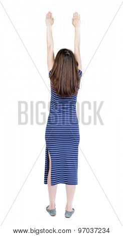 Back view of  woman.  Raised his fist up in victory sign.  Rear view people collection.  backside view of person.  Isolated over white background. Girl in a blue striped dress flying in Superman pose.