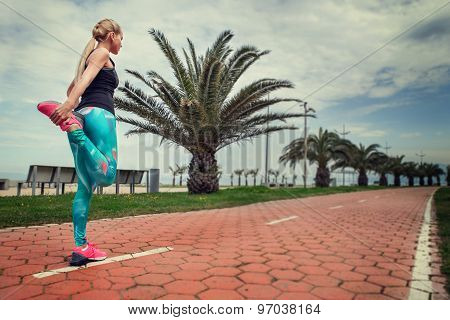 Young Woman Warm Up Legs Before Start Jogging