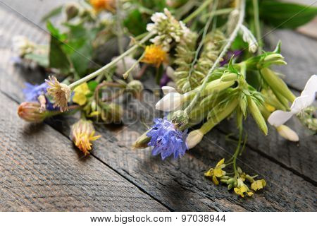 Wildflowers on wooden table, closeup