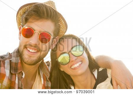 Young couple at the beach and having fun