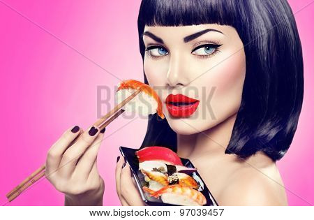 Beauty Fashion model girl eating Nigiri Sushi with chopsticks. Beautiful sexy woman with perfect make up and bob haircut eating healthy japanese food. Diet, dieting concept.