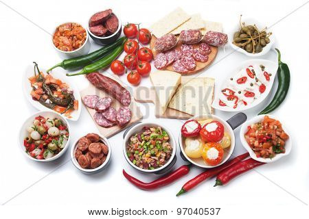 Tapas, antipasto or meze, traditional mediterranean cold buffet food isolated on white background