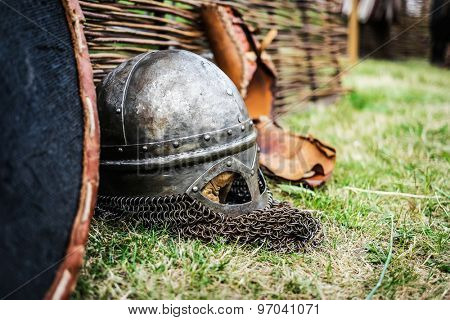 steel knight helmet with chain armour on grass
