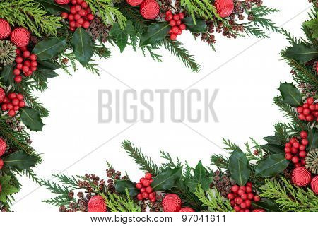 Christmas abstract background border with red bauble decorations, holly, ivy, pine cones, cedar cypress and  fir over white.
