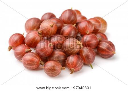 Heap of red gooseberry isolated on white