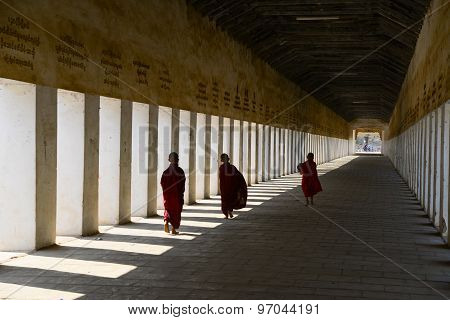 Monks in the entrance of Shwezigon Pagoda in Bagan, Myanmar