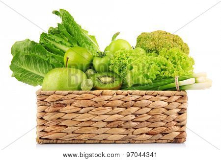 Fresh green food in wicker basket isolated on white