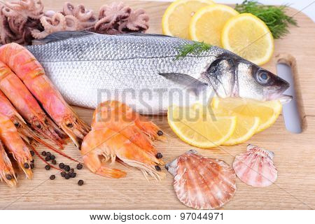 Fresh zander fish on wooden cutting board, closeup