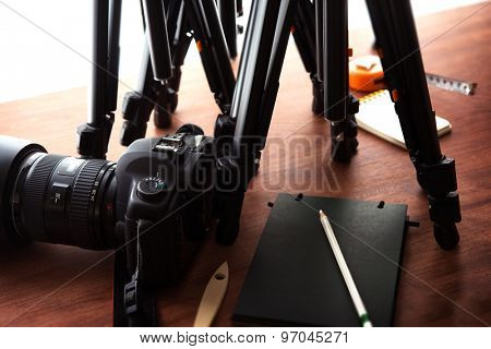 Tripods and DSLR camera. Ready for filming or photo session. Photography equipment.