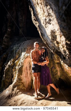 Woman And Man Kiss In Cave
