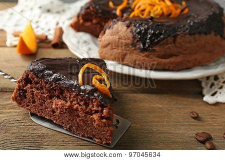 Cake with Chocolate Glaze and orange on wooden background