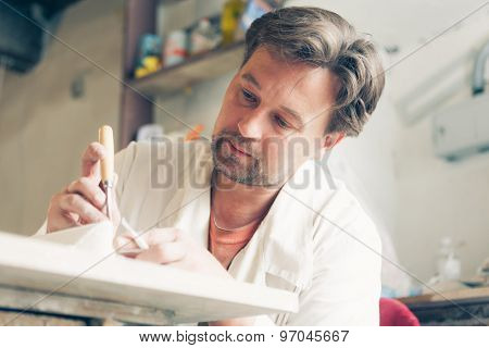 restorer making his work