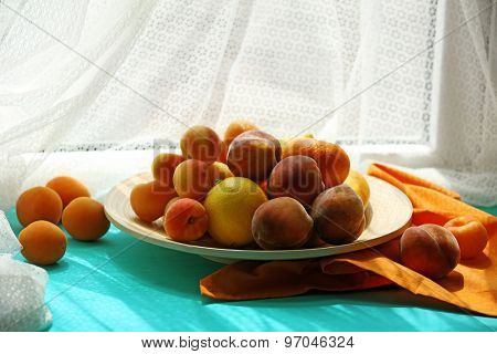 Heap of fresh fruits on windowsill