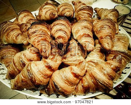 Fresh Croissants in a basket on table