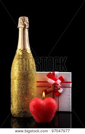 Decorative champagne bottles on dark background
