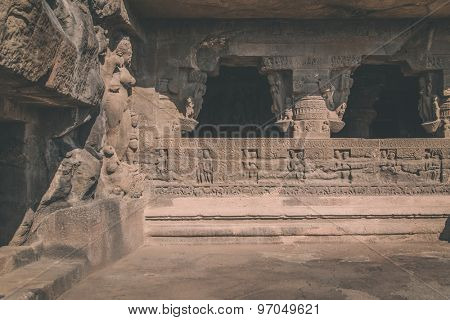 ELLORA, INDIA - 14 JANUARY 2015: Ellora Caves is an archaeological site close to city of Aurangabad. Ellora is a World Heritage Site. Processed with grain, texture and color effect.