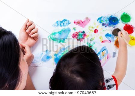 Asian Girl Painting And Using Drawing Instruments, Studio Shot. Top View