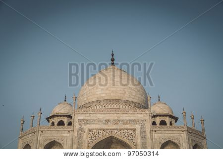 Close up view of Taj Mahal from East side. Roof part. Post-processed with grain, texture and colour effect.