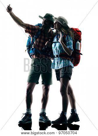 one caucasian couple trekker trekking selfie nature in silhouette isolated on white background