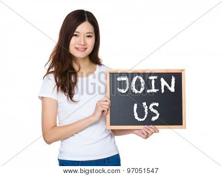 Woman with the chalkboard showing phrase join us