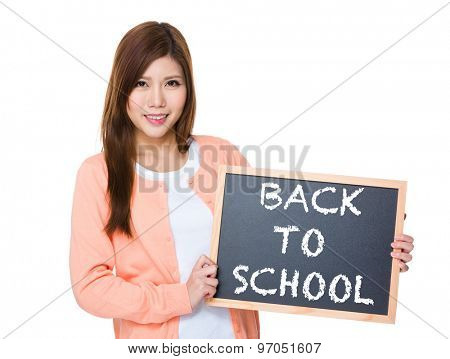 Woman hold with blackboard showing phrase of back to school