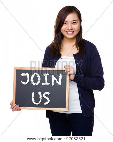 Woman showing the chalkboard with phrase join us