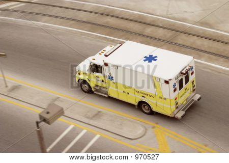 Panning Ambulance Paramedic Racing Down The Road