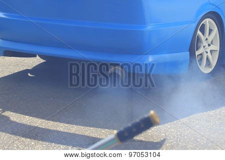 Smoke Out Of The Exhaust Pipe Of A Car