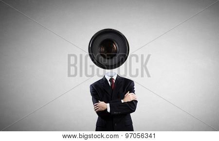 Faceless businessman with camera zoom instead of head