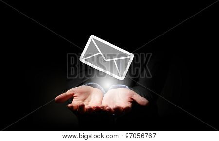 Close up of businessman hand holding email sign
