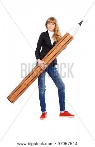 Full length portrait of a smart student girl posing with huge pencil. Educational concept. Isolated over white.