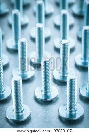 bolts tool at metal background texture