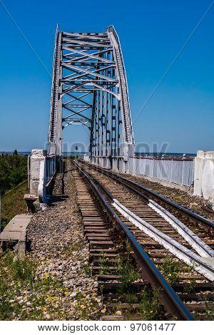 Railway bridge across the Canal against the blue sky