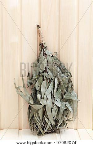 Eucalyptus Broom For A Bath On A Wooden Surface.