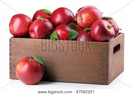 Red apples in wooden crate isolate on white