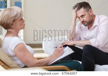 Depressed Businessman With Psychoanalyst