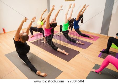Big Group Of People In A Yoga Studio