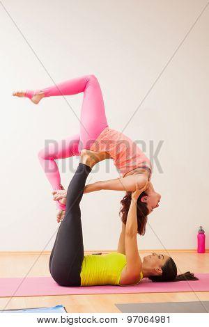 Beautiful Girls Doing Acrobatic Yoga