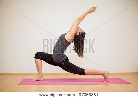 Low Lunge In A Yoga Studio