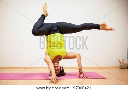 Practicing A Headstand With A Leg Split