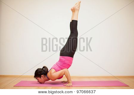 Strong And Flexible Woman Doing Yoga