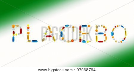 The word Placebo made with pills on color background