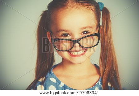 Funny Smiling Child Girl In Glasses