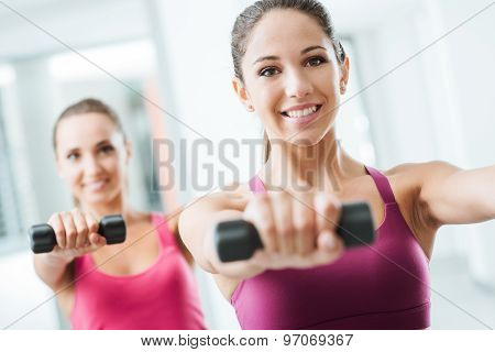 Sporty Girls Weightlifting At Gym