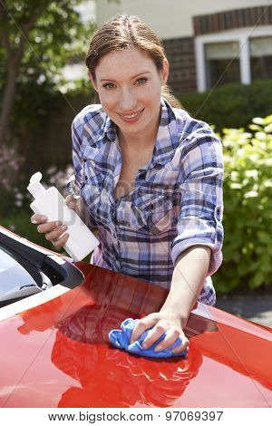 Portrait Of Woman Waxing Car Outside House