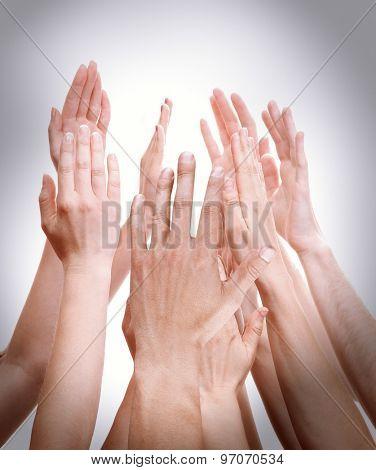 People's hands together on light background