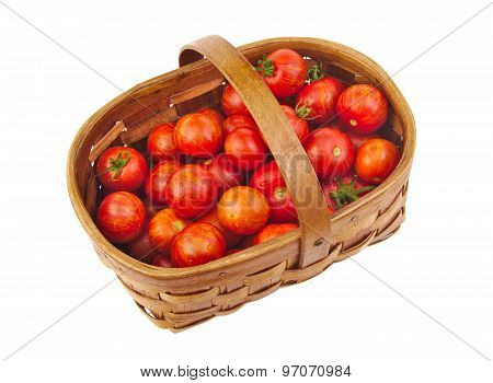 Fresh red cherry tomatoes in a basket isolated white background