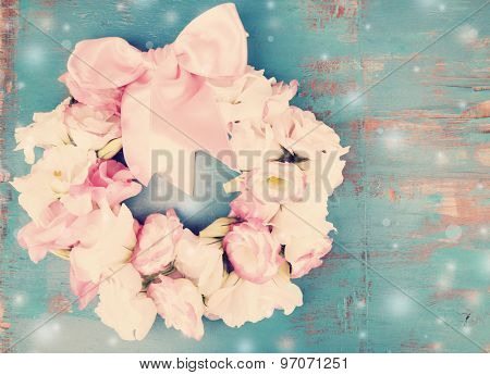 Beautiful wreath of flowers on wooden background