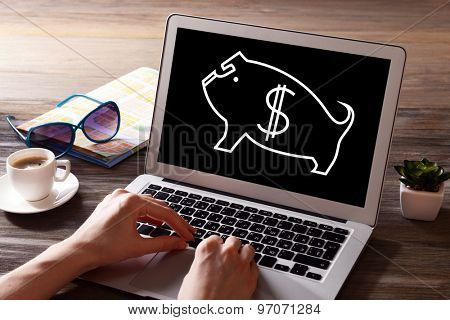 Money concept. Businessman working with laptop at wooden table, closeup